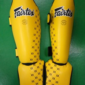 Fairtex shin guards for competition yellow black